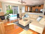 Spacious Open Living Area w/Leather Sectional Sofa Offering Direct Outdoor Heated Pool & Lounge Area