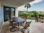 Patio facing sand dune and tropical landscape.  Patio is just steps from the pool, boardwalk , beach