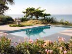 The house has a pool near the sea