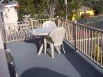 Outside deck with patio table and 6 chairs. There is a gas BBQ grill. It has a great ocean view!