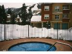 Hot tub with condo unit in background