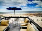 Relax under your umbrella on your private deck.