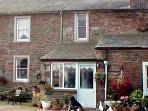 FOXGLOVES COTTAGE, pet friendly, character holiday cottage, with a garden in Wig