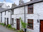LLANNERCH, romantic, character holiday cottage, with open fire in Betws-Y-Coed, Ref 3513