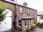 2 EDEN GROVE COTTAGES, pet friendly, character holiday cottage, with a garden in Armathwaite, Ref 3577