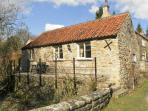 BECKSIDE, luxury holiday cottage, with a garden in Lastingham, Ref 1293