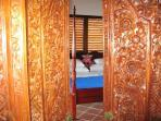 Balinese Doors into Master Bedroom