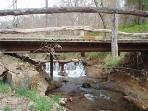 bridge and creek at entrance to property