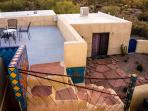 Looking down on roof deck and guest room