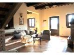 Il Raggio, sunny and spacious living room with fireplace and double sofa bed