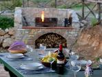 One of the farmhouse terraces has a large stone barbecue