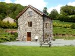 THE OLD MILL, pet friendly, character holiday cottage, with a garden in Llanfyllin, Ref 1799