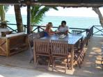 Guests enjoy the outdoor dining bure