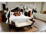 Grand Master Suite bedroom; large deck overlooking jungle and ocean