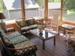The screened in porch is perfect for board games, playing cards, or just talking together.