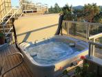 The hot tub is located off the guest bedroom on a lower deck.