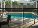 Private screened-in pool area