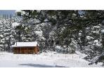 A Christmas postcard: our Harney View cabin is shown draped in a mantle of freshly fallen snow.