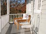 Enjoy our sunny front porch on a warm fall day.
