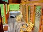 Huge Covered Front Porch with over sized rockers!  Hot Tub over looking the meadow, horses & Mts!