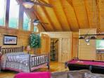 Huge Cathedral Ceilings span the entire length of the cabin leaving you with a feeling of grandeur!