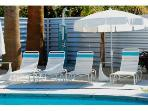 Chaises/Shower area with an inside pool tanning ledge