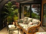 Solarium with sliding doors to deck and yard