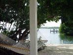 Tiki hut view through hammock