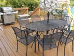 Wrought iron table with plenty of seating on the back deck.  Gas grill too!