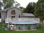 View of rear of house.  Faux balcony of master bedroom overlooks pool.
