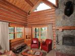 A wood-burning fireplace in the middle of the great room warms the home on a chilly evening.