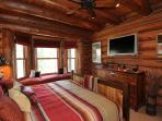 The master bedroom is located on the main level of the home and it beautifully decorated with western décor.