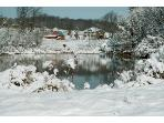 the farm and pond in snow