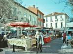Outdoor markets for fresh fish, meats, cheese, bread and of course, wine!