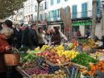 Walk to the farmers market, held three days/week