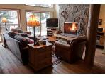 Comfortable Leather Furniture, Big Screen TV, and Fireplace