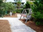 Outdoor swing at the playground and shuffle board areas.