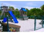Childrens Play Ground. Swings, slides.  Condo also has lots of toys for beach use.