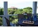 Screened deck with dining for 6 and cushioned chaise seating to enjoy great views of the surf