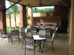 Pool shaded patio area with stainless steel barbeque