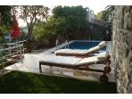 Pool side with comfortable loungers