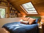 master bedroom with star-gazing, river-listening skylight