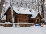 Winter at the cabin is magical with a cozy wood stove and plenty of wood provided