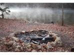 The fire pit with the morning mist over the lake.