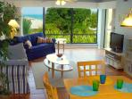 Living room with beautiful view in your AnnaMariaBeachCondo Tropical Sunset #2!