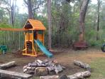 Childrens Cubby & Playground showing our firepit (for roasting marshmallows!)