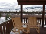 Sit on the private covered deck in your own log rocking chairs