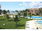 View from your main terrace to lawns and pools