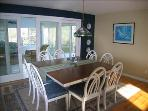 Dining Room with 3 season room in background