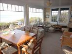 Dining area/ seating area with water views